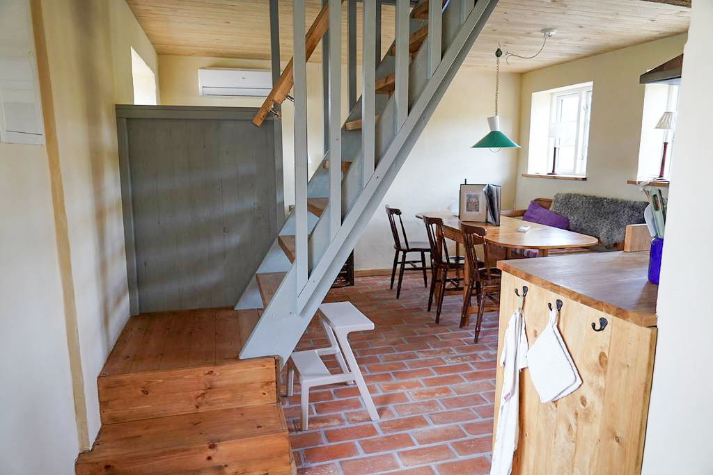 The stairs lead you from the kitchen to the bedrooms.