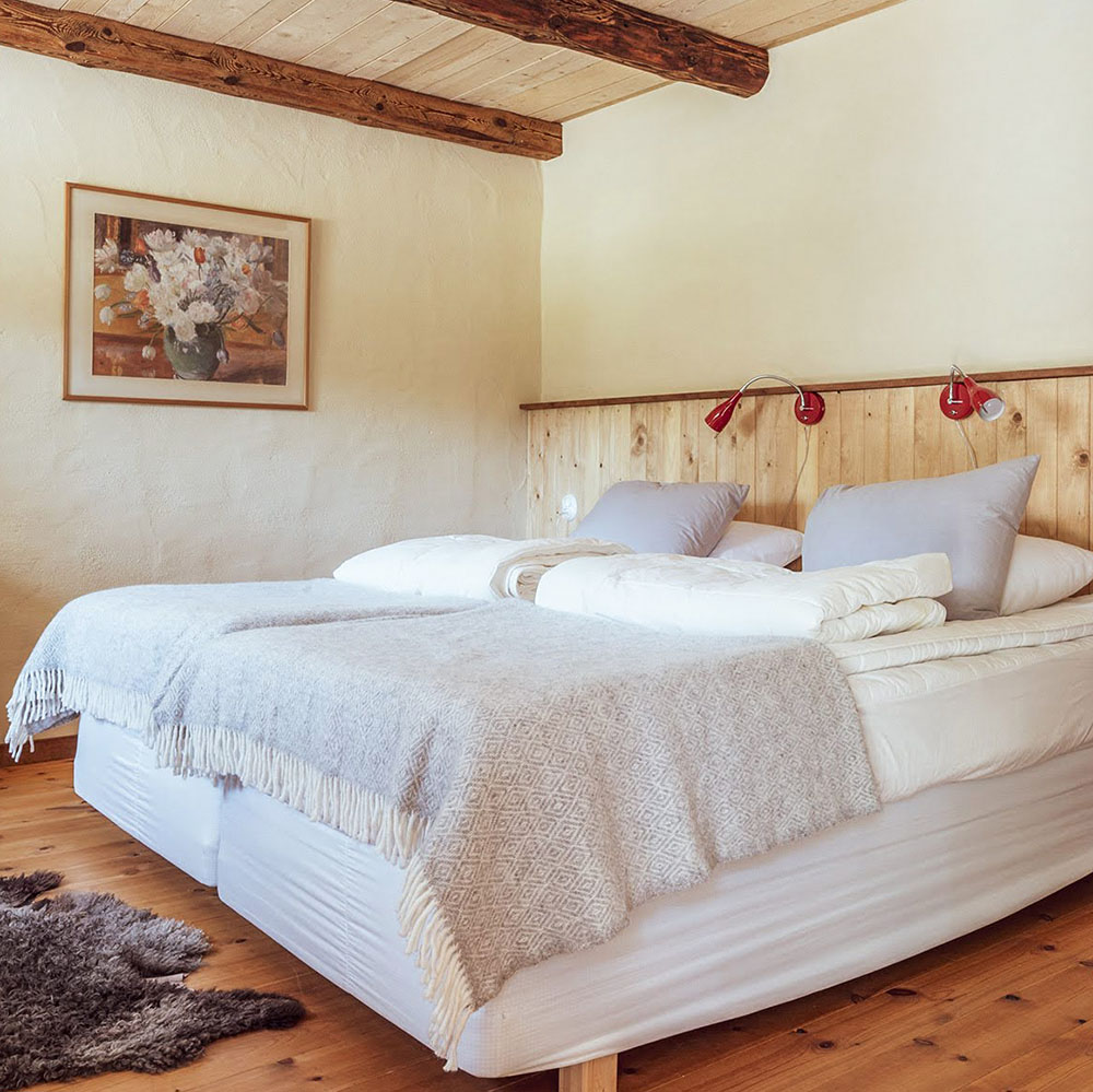 The bedroom with a courtyard window is one of three bedrooms with double beds in the big courtyard apartment.
